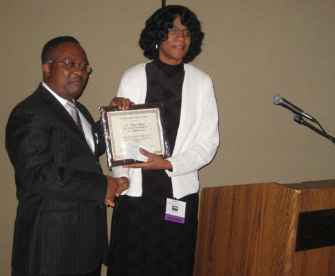 Professor Receiving Award for Excellence in Research and Communication